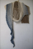 "Lace beaded shawl knitted of long gradient dyed fingering weight cotton. The colour is ""Ebb Tide""."