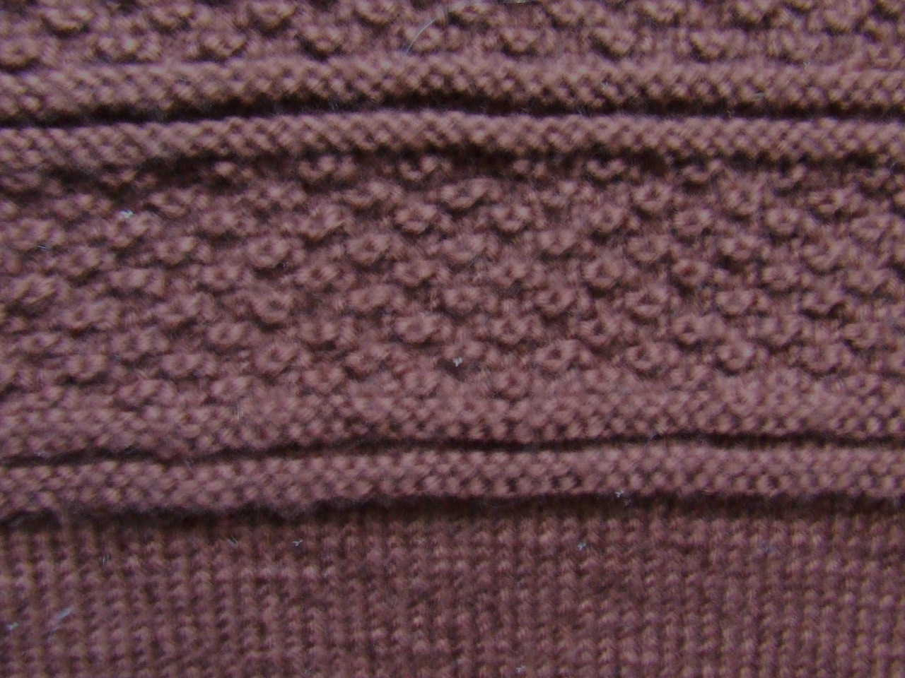 Brown gansey detail